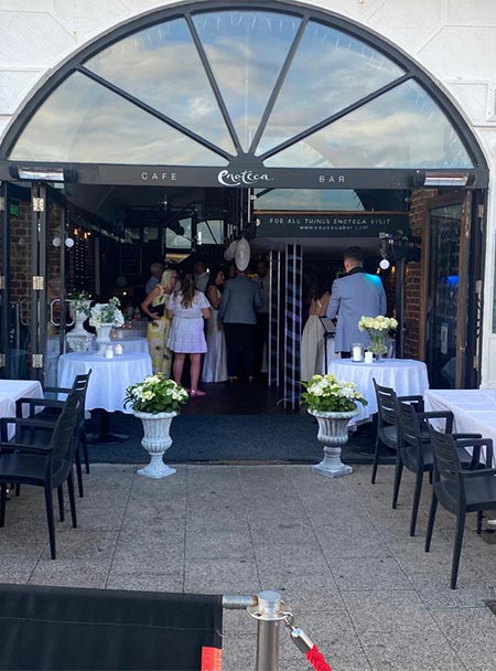 Enoteca Bar exterior with guests for wedding